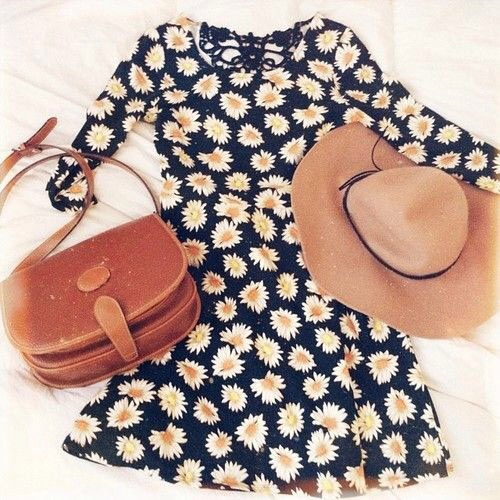11. Go for a serious boho vibe by wearing a loose floral dress with a big floppy hat.