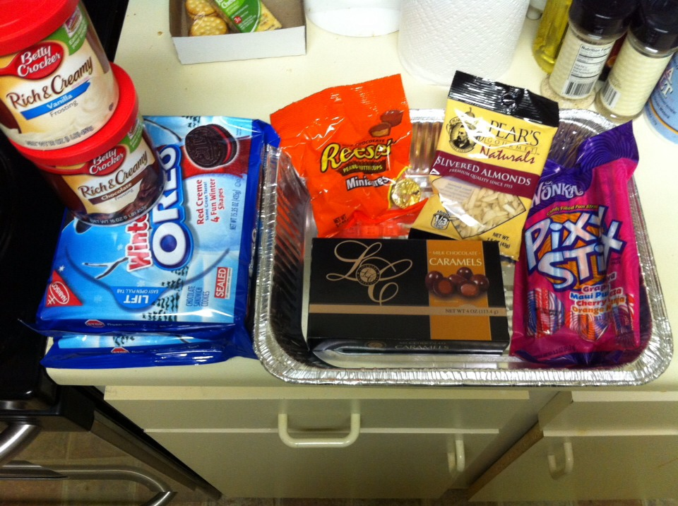 The pan and everything in the pan are all from the dollar tree! I got the holiday Oreos because the red filling goes with thanksgiving  Only bought chocolate and vanilla icing.  (You may want to grab a few colored icings or food coloring but I colored mine with the pixy sticks from the dollar store!