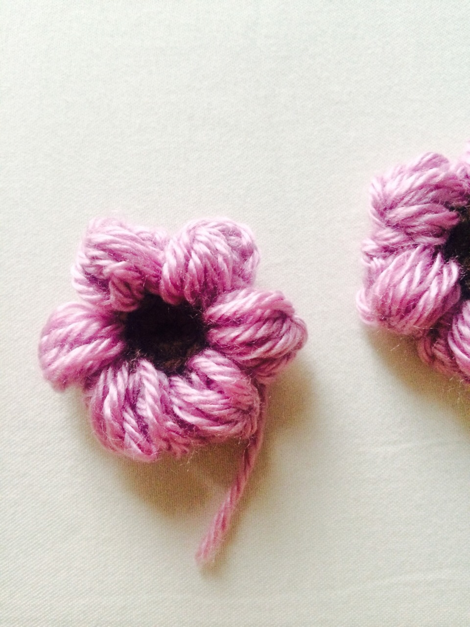 Keep making petals till you have six, slip stitch to first chain of first petal, tie and cut of excess yarn.