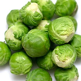 Steam or heat up Brussels sprouts and top w/ cheese and salt.