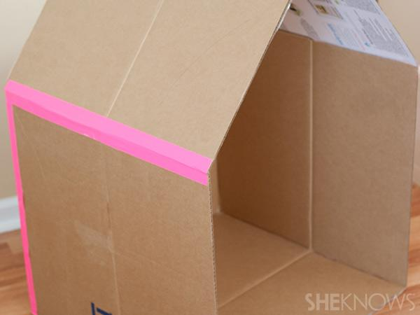 7. Build the house Tape the roof and the cardboard playhouse together.