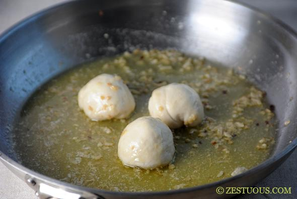 Roll the dough balls into the butter.