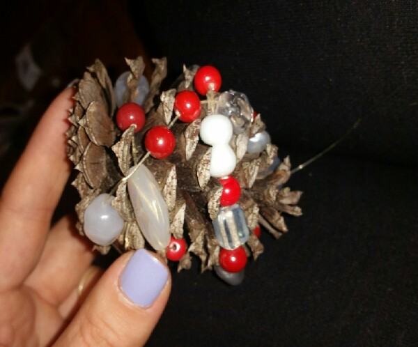Wrap your strand of beads around your pine cone.