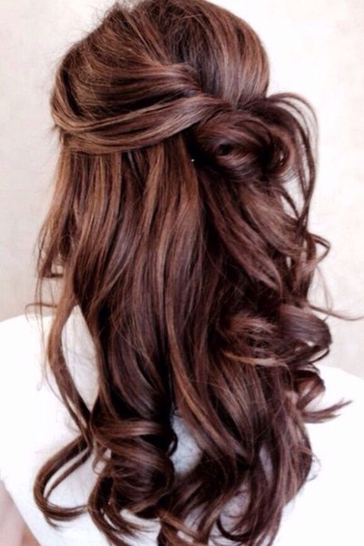 This slightly dressier twisted look is a unique take on a classic half-up hairstyle.