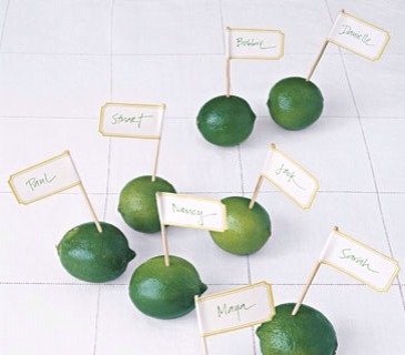 Delightfully bright and pleasingly oval,limes are much too pretty to be sidelined as mere garnish. Instead,give them a starring role as placeholders.Write out each guest's name on one end of a sticky file label,center the label at the dull end of a small wooden skewer (or a toothpick)-