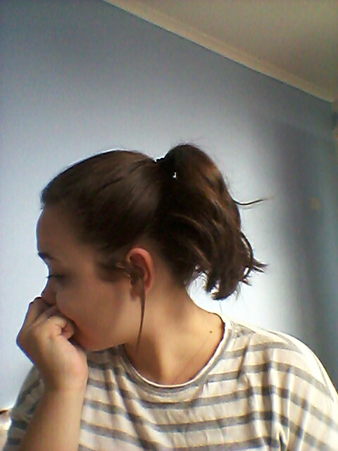 Pull your hair into a high ponytail and loosen some pieces so the look is soft.