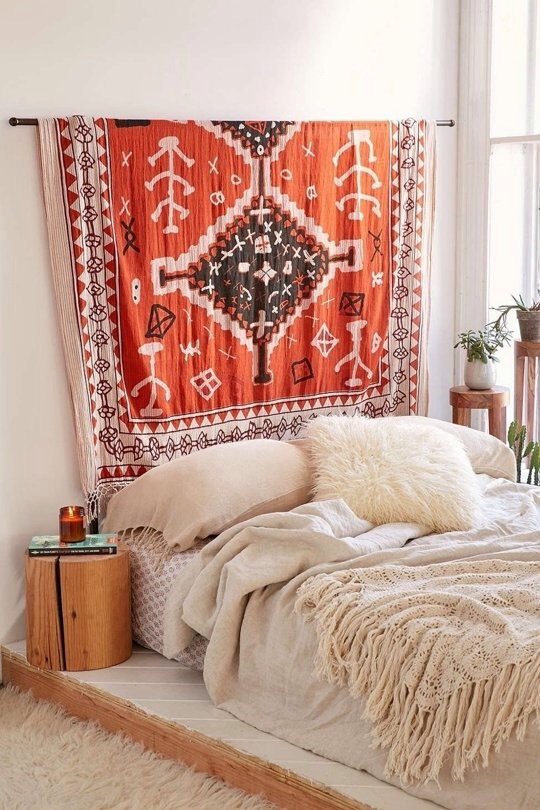 Above: Hanging a tapestry, quilt or rug above your bed is a great way to add a little bit of style and a little bit of cozy texture to any bedroom. This rod for displaying tapestries is fromUrban Outfitters, or if you're handy you could simply mount a curtain rod to the wall above your bed.