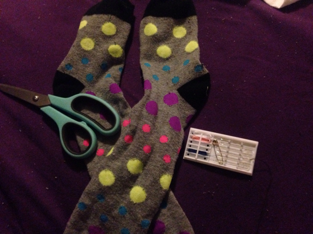 All you need is a pair of socs, scissors, needle and thread