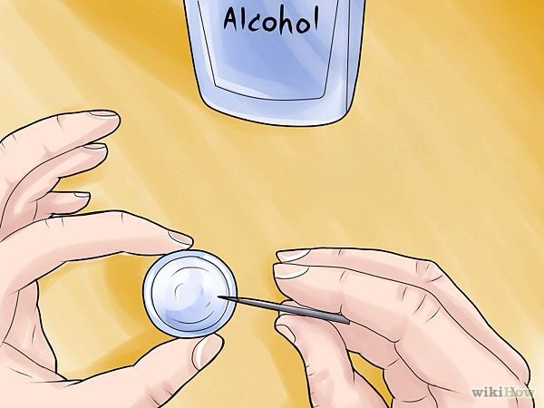 Take a different small container and put the needle in alcohol also to soak. This will sterilize it.