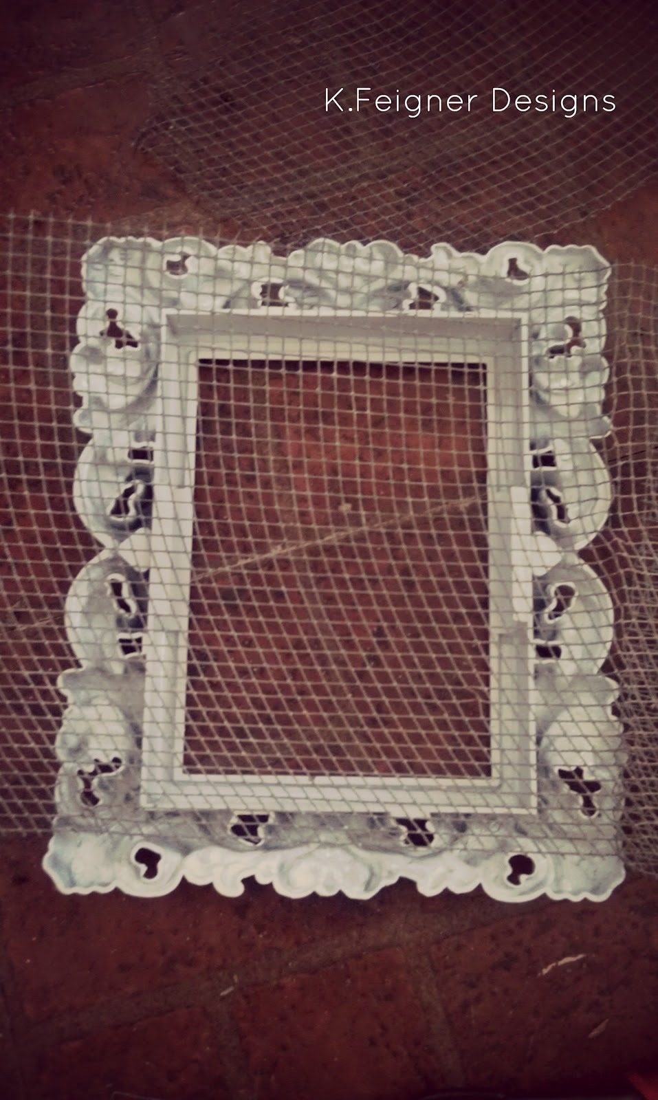 Place the net on picture frame. And glue it then cut off all excess lace in frame.