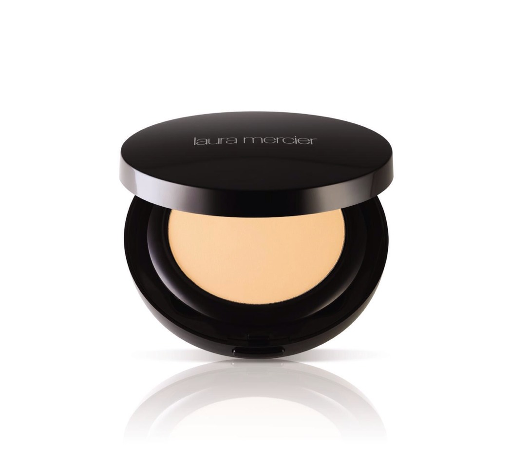 Next, I powder with Laura Mercier's finishing powder. It doesn't look cakey, and it really gives you a porcelain effect.