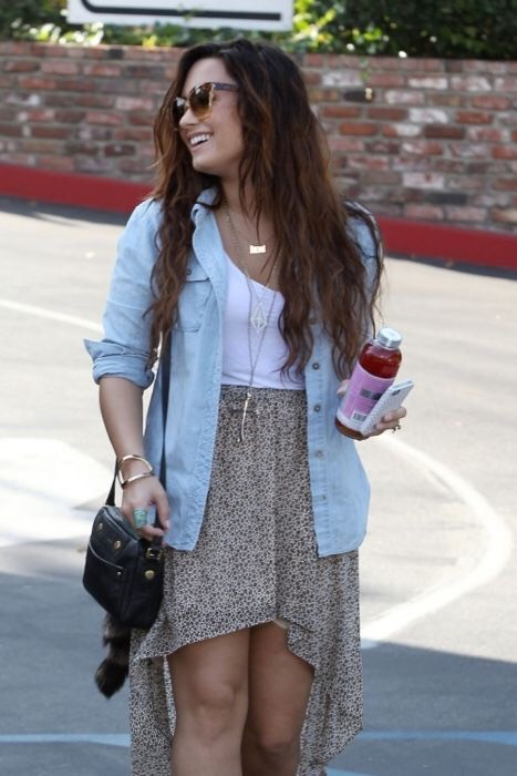 Hi-lo skirt, white tank top, denim button down. Simple and summery. You go Demi. 👌