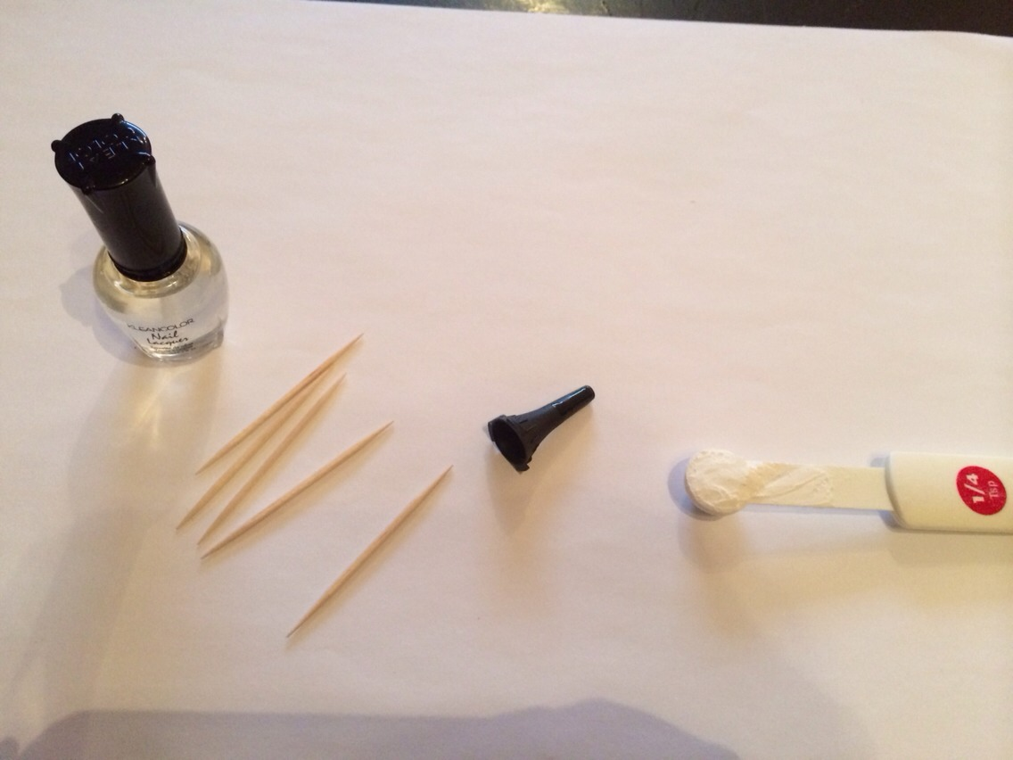 Full bottle of clear nail polish.  Toothpicks (optional). Funnel.  1/4 teaspoon of Cornstarch.