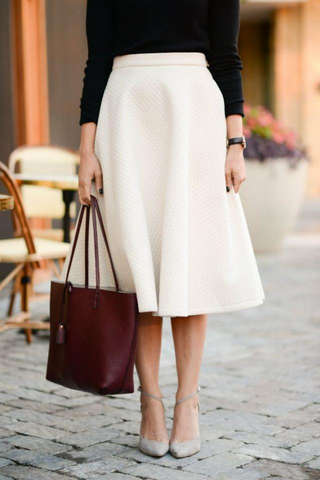Midi Skirt: Seen throughout the many years of fashion the midi skirt has made a comeback. The below the knee fit is sure to keep an outfit classy while still maintaining the feminine sexy feel. The skirt should fit your natural waist to give it the classic feel.