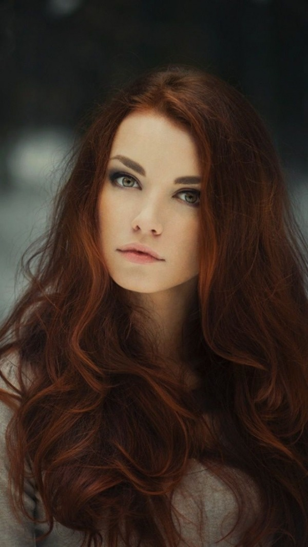 Auburn is another popular choice for 2014. This color is a great hue to wear in the fall and winter. While auburn is traditionally a blend of red and brown, if you're feeling extra daring this year, you can even add a purple tint to your auburn hair.