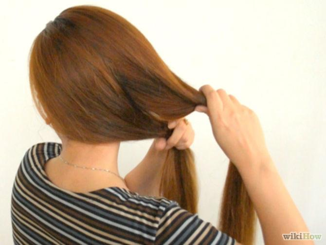 2. Twirl your ponytail. You will want to twirl it into a tight coil with as few hairs escaping from the spiral as possible. Twist the spiraled hair around the base of your ponytail. Make sure to tuck in any loose ends.