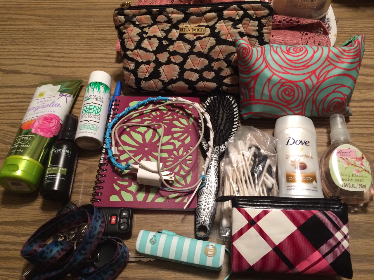 This is what's in the big part of my purse. Lotion, hairspray, dry shampoo, notebook/pen, keys, a brush, charger, power bank/charger (power bank has a flash light in it), a bag (with q tips, Bobby pins, & hair ties), deodorant, perfume, gum, make-up bag, wallet, & a first aid kit.