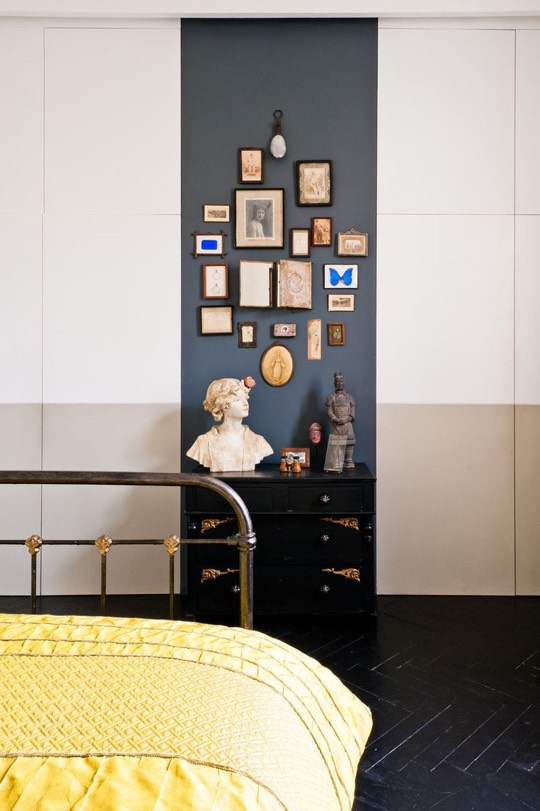 A wide painted stripe on the wall can help to highlight a series of small frames, as seen onStyle Me Pretty.