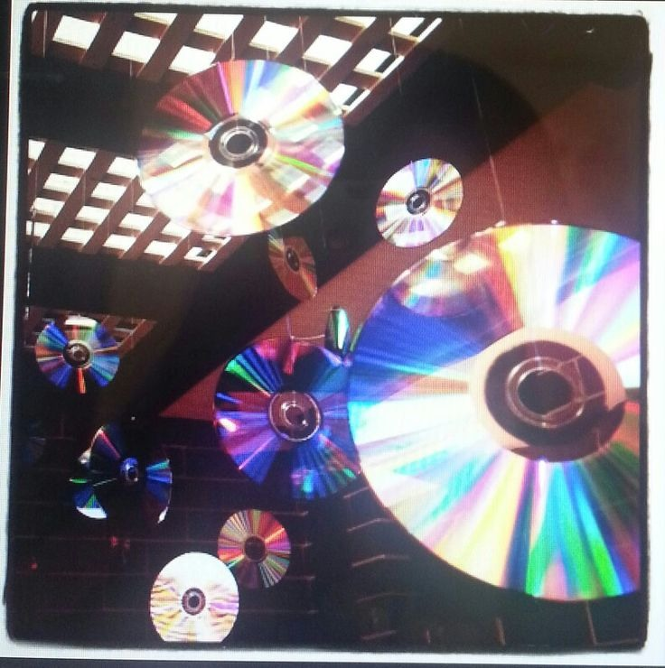 Hang CDs from the ceiling! Use blank unused ones. Once they are hanging, the light will reflect off of them and create a nice look to your room!