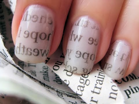 paint your nails white dip in rubbing alcohol and press against newspaper for at least 30 seconds and peel off. (like a tattoo)
