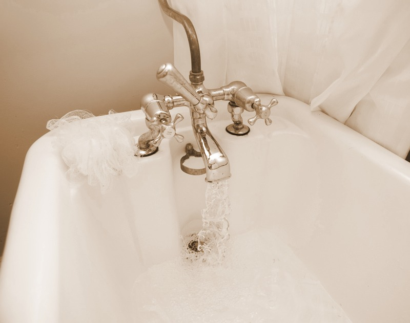 Soak your fingers for 1 minute under hot running water with a tiny amount of soap