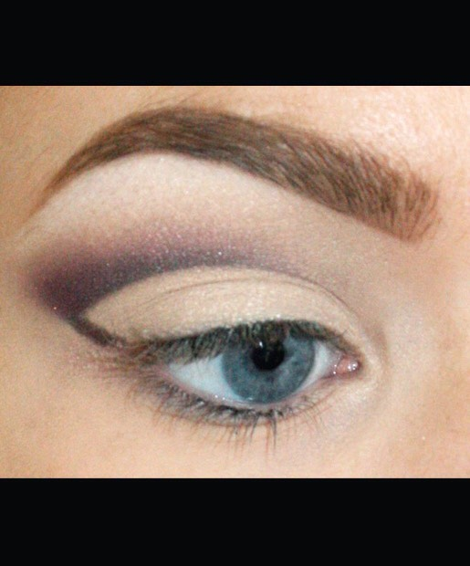 Using the top line of your eyeliner as a guide, apply any eye shadow you'd like (pictured: MAC Eye Shadow in Plum Dressing) over the line and slightly above it, blending in toward the inner corner of your eye. You can also clean up any mistakes along the way with your white eyeshadow.