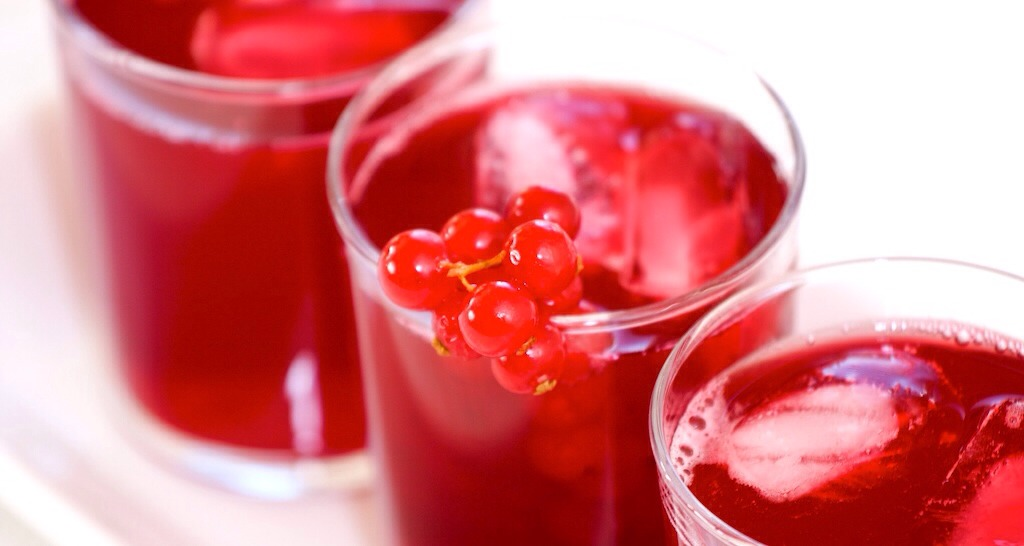Cranberry juice is the thickest consistency so it will go on bottom