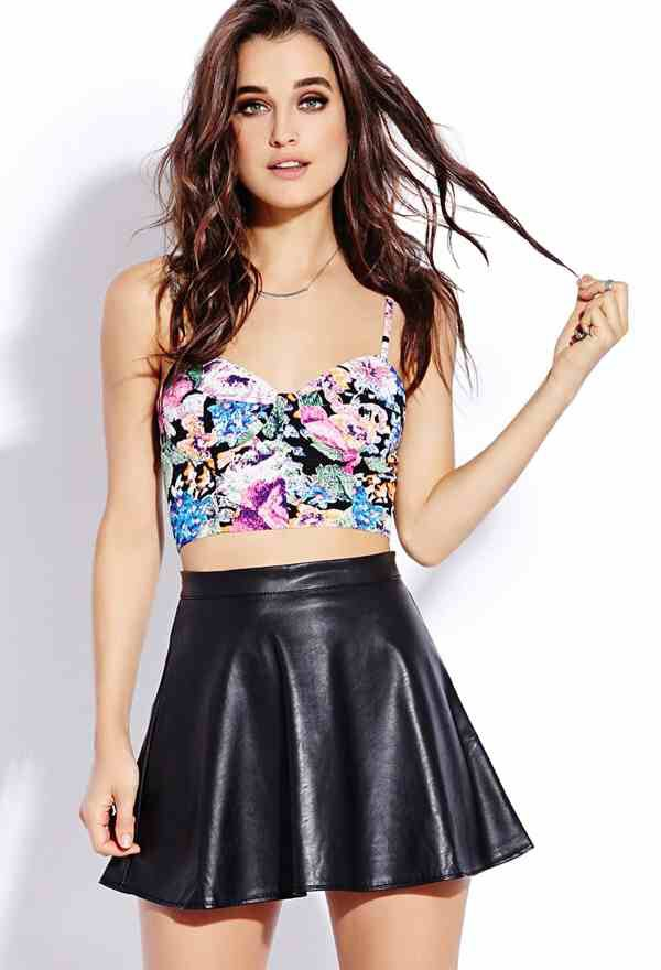 Crop Tops  Midriff-baring tops are back for round three but in a more sophisticated way. Less tummy and more elegant pairings—high-waisted skirts and trousers—make this trend special for 2015.
