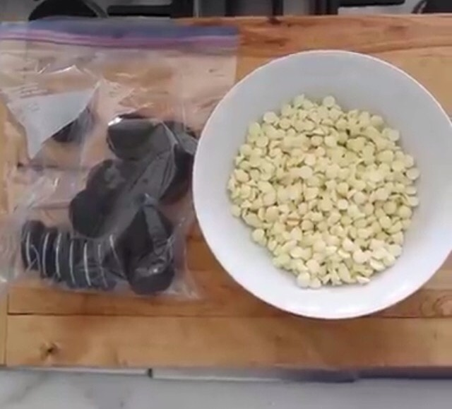 Dump a bag of white chocolate chips into a bowl and put Oreos into a large plastic bag