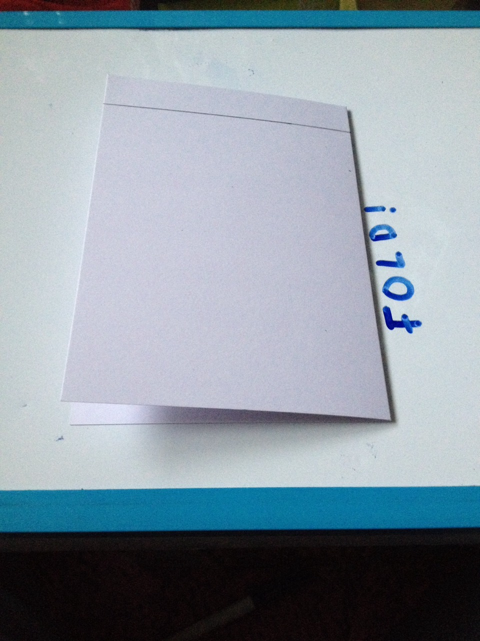 Make a line 2 cm from the top of the card