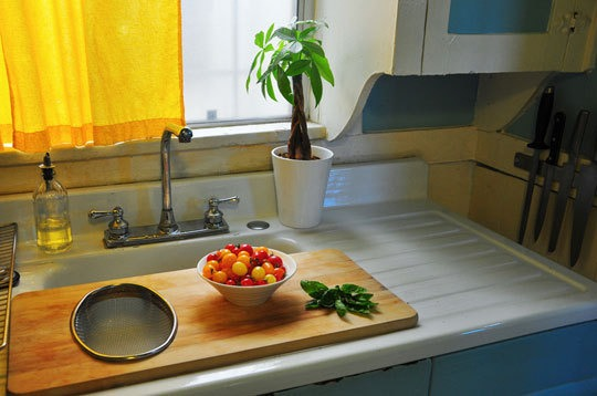 Use a long chopping board that you can place over the sink to give you more counter space while cooking.