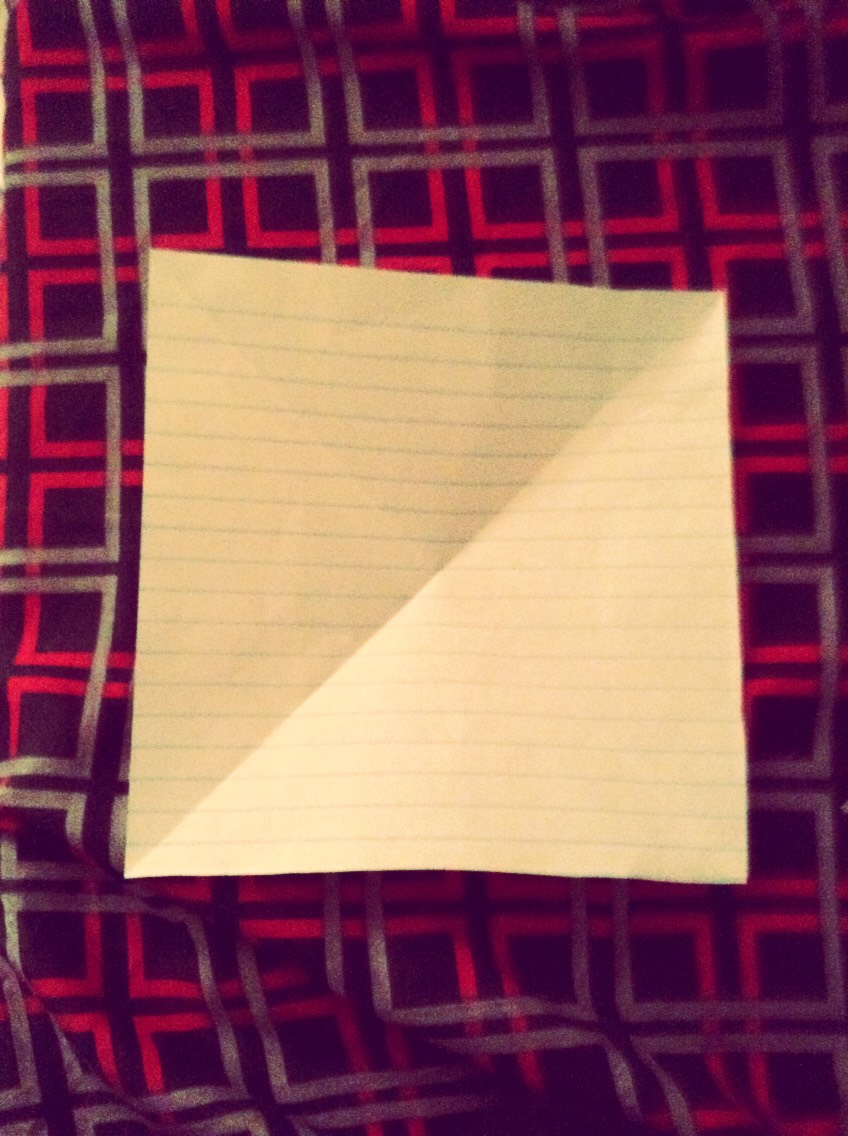3) Cut the bottom part so it becomes a square piece of paper.