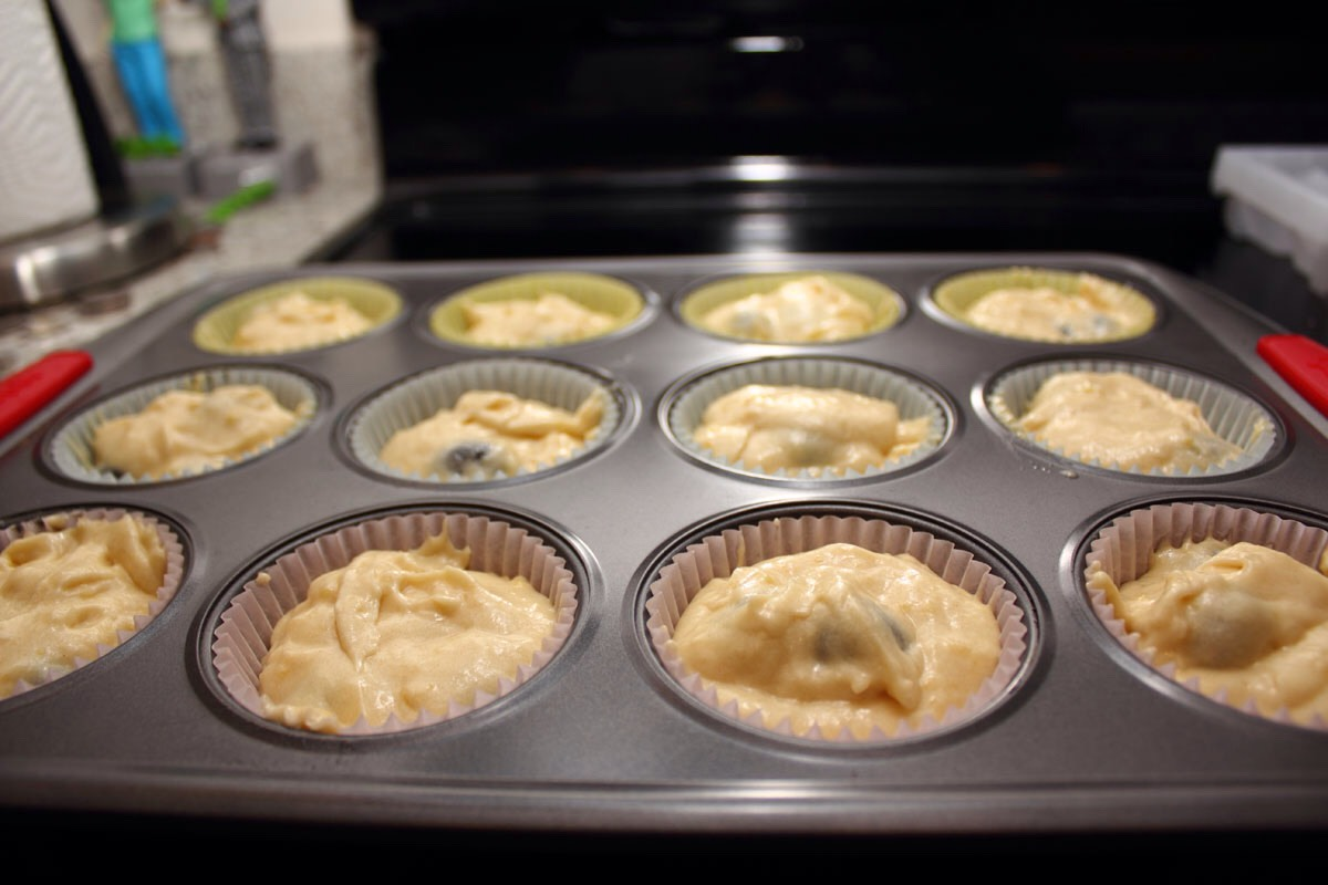 Preheat oven to 375f or 170c; line muffin cups with papers. cream butter and sugar till light and fluffy. beat in eggs one at a time. add flour (mixed with baking powder and salt) alternating with milk beat well; stir in vanilla. divide evenly among pans and bake for 18 minutes. let cool in pans