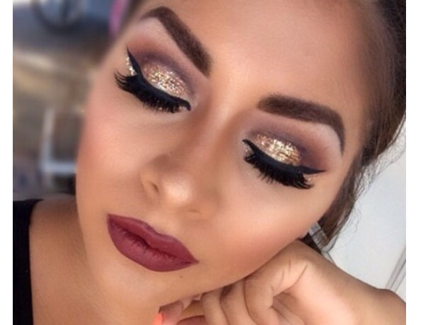 18. Gold glitter cut crease, winged liner, magenta lip.