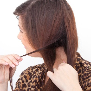 Grab a piece of hair about 1/2in. - 1in. and place it into the Conair Curl Secret