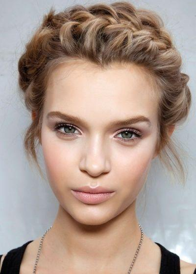 To achieve a more natural look, use light makeup on the face, like a tinted moisturizer or CC cream. Set the cream with a pressed powder, and follow-up with some bronzer where the light would naturally hit your face. Finish with a peachy blush and nude lip.