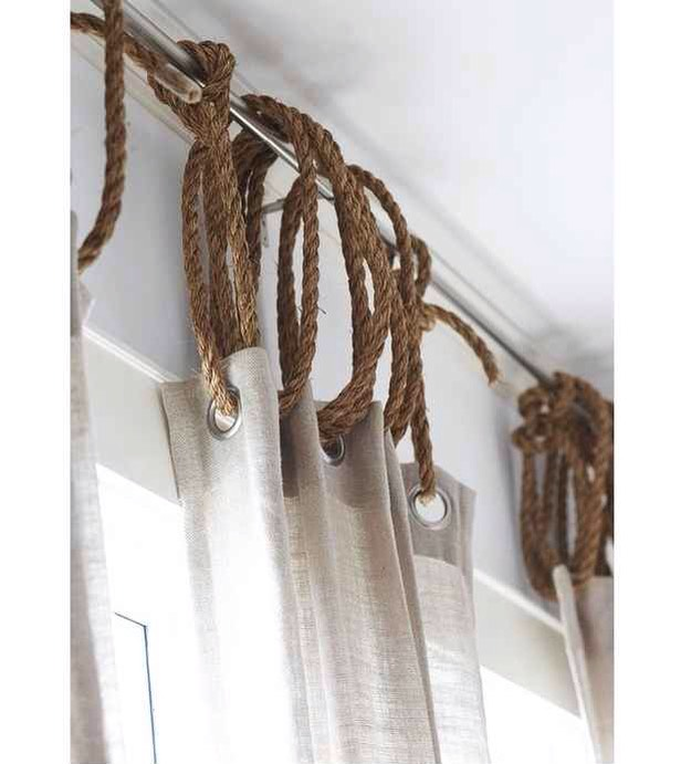 8. Jute rope is a cheap way to add a rustic/nautical touch to any window dressing. Bonus points if you incorporate a sailor's knot.
