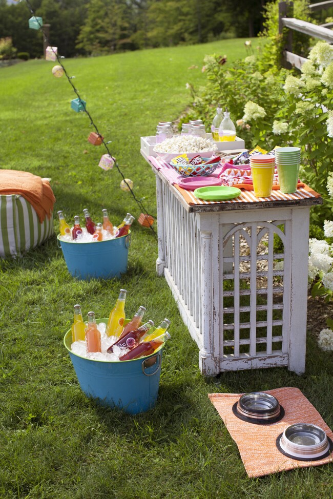 Instead of using coolers, use these vintage buckets with ice for keeping drinks cool.