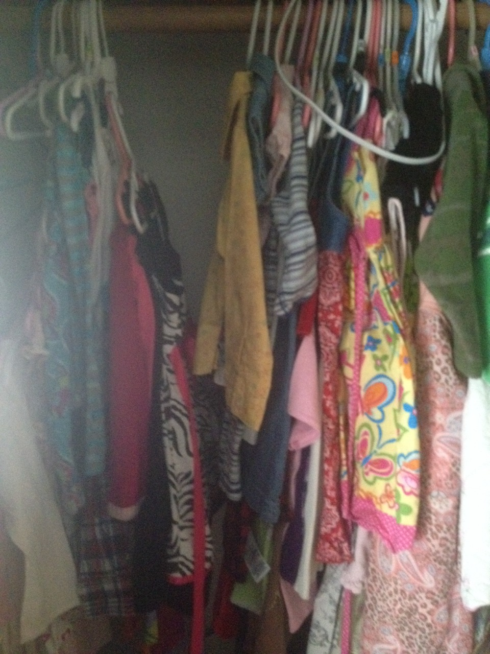 When done the hangers swing right back into the closet