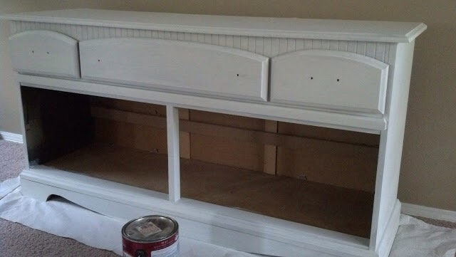 First thing hubby did was take out the drawers and support beams inside the dresser (not shown).  He also cut, painted, and installed a long board (the length of the dresser) for the bottom of the dresser for additional support for the baskets.