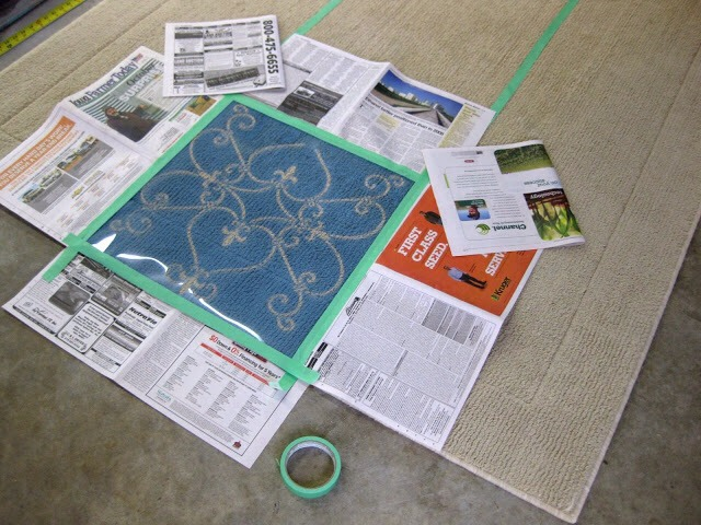 Since there are to be 3 stencils on the 5′ side, I divided the rug evenly with tape going long-ways. Losing the width of the tape ended up being ok because there was some extra space when laying out the stencil 3 times. Make sense? No?