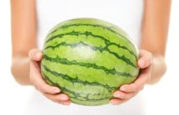 Pick up the watermelon. If it is heavy for it's size, this is a good sign because it means it has a lot of juice.