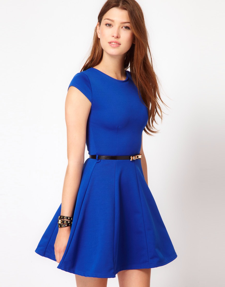 For a more classy look, colorful fit and flare dresses always are a huge hit! It doesn't have to be colorful, like this dress; it could be a simple black or white dress, and look amazing as well.