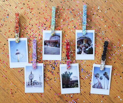 An easy diy is to simply add glitter to clothes pins and simple display them any way possible