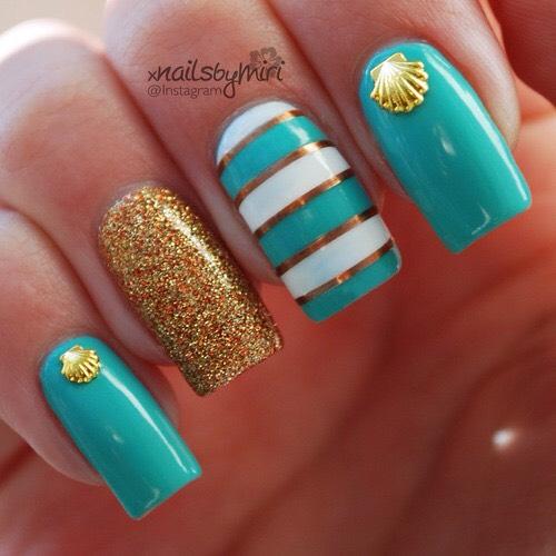 Beautiful striped and glitter nail art.