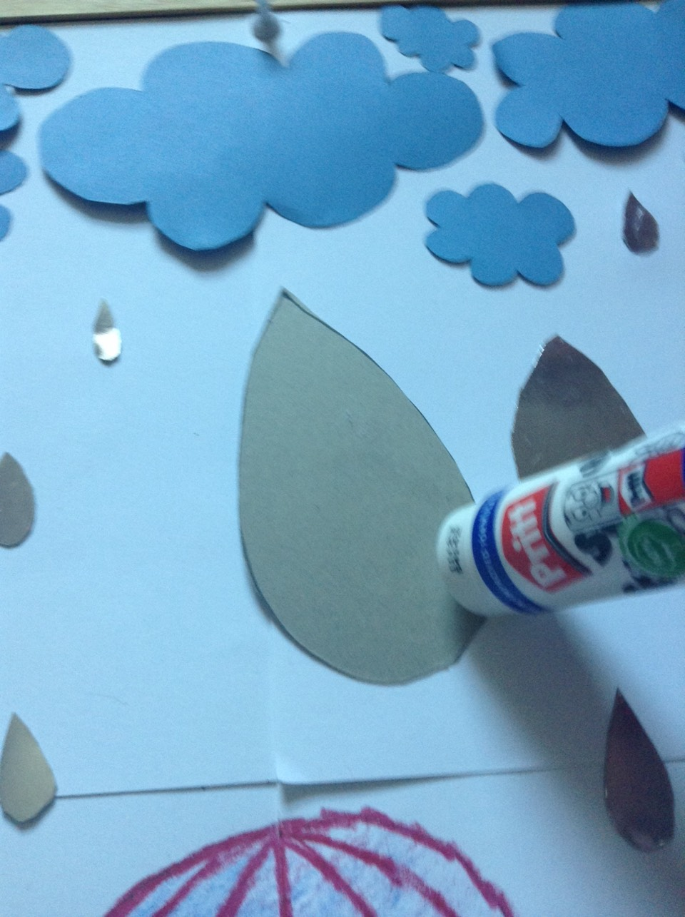 Glue on raindrops with pritt-stick