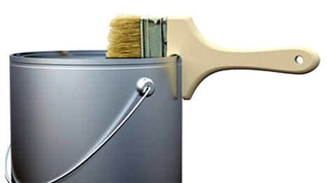 Your paintbrushes could hang on the rim of paint cans.