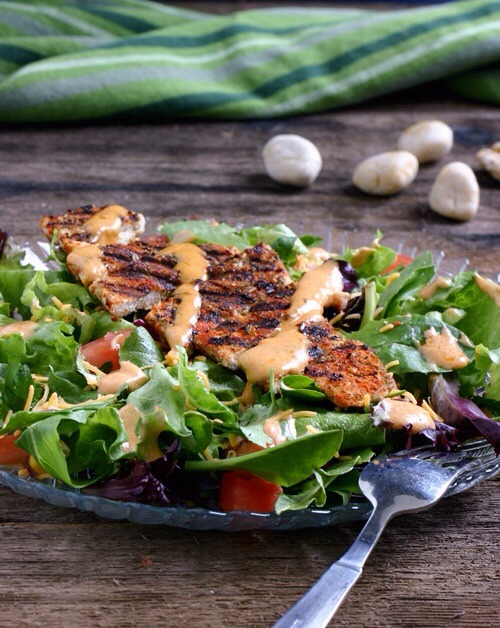 Sante Fe Chicken SaladThis salad packs some serious spice! Between the dry rub on the chicken and the dressing with cumin, paprika, and coriander, your taste buds will be thanking you.