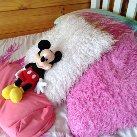 Pop some cushions on your bed to make it more comfy looking and maybe add s soft toy (the Micky mouse soft toy is from Disney land)