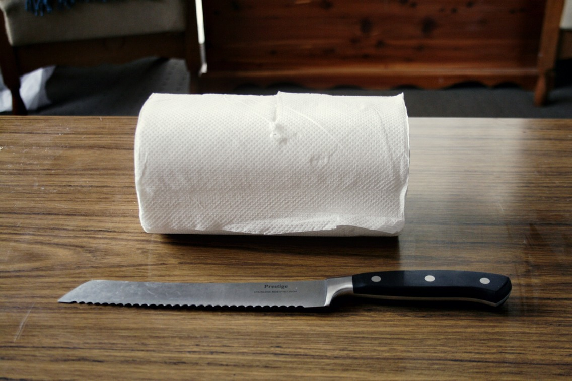 -Cut the paper towel roll in half using a sharp knife. I used a bread knife. Place the half roll into your container. -Mix the olive oil and baby shampoo in the warm water. Stir it quickly to make sure it's nicely mixed.